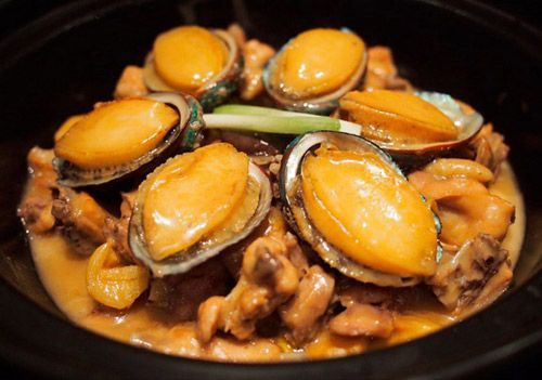 Abalones stewed with chicken, Guangdong food.