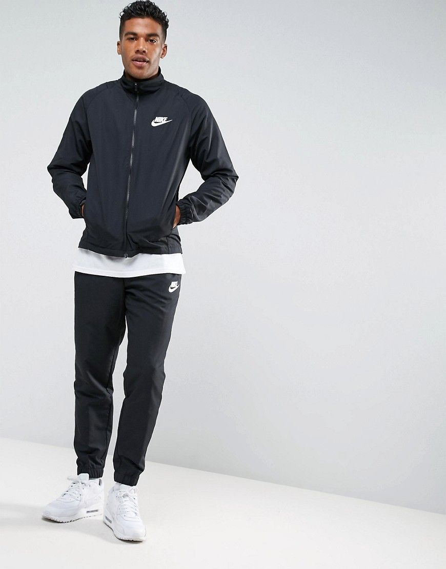820c3a658e59 Get this Nike s track trousers now! Click for more details. Worldwide  shipping. Nike Tracksuit Set In Red 86…