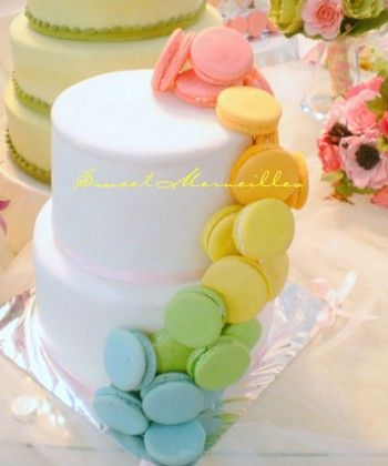 macaroon waterfall - I hate macaroons but other people don'tor  this could look neat with a rainbow waterfall  of  pebbles
