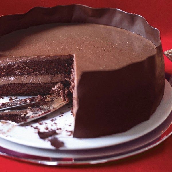 A creamy chocolate pudding fills this rich         cake and an easy-to-make chocolate band         wraps it up in style.