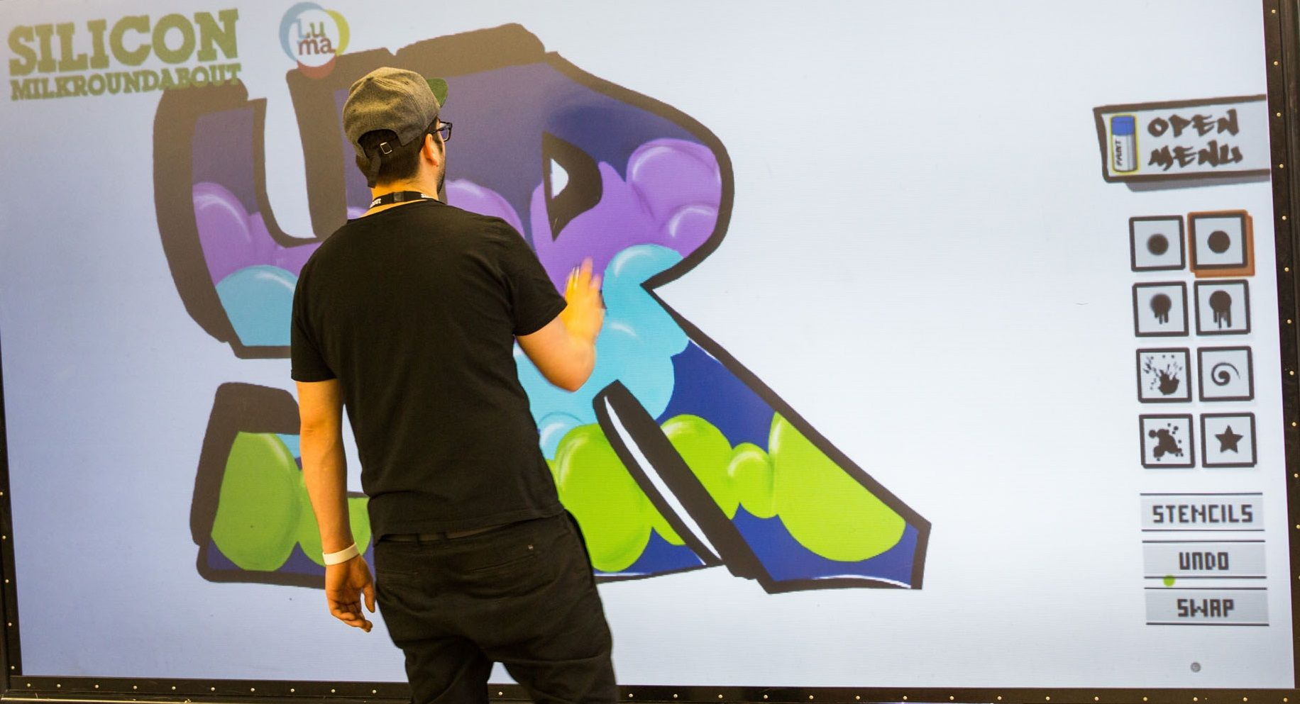 """At #SMR4: Thank you to Luma (http://thisisluma.com) for their amazing YrWall - """"a graffiti experience with a digital twist - giving you the chance to design your own graffiti masterpieces without mess, again and again"""". YrWall was at Silicon Milkroundabout 4.0 and 5.0."""