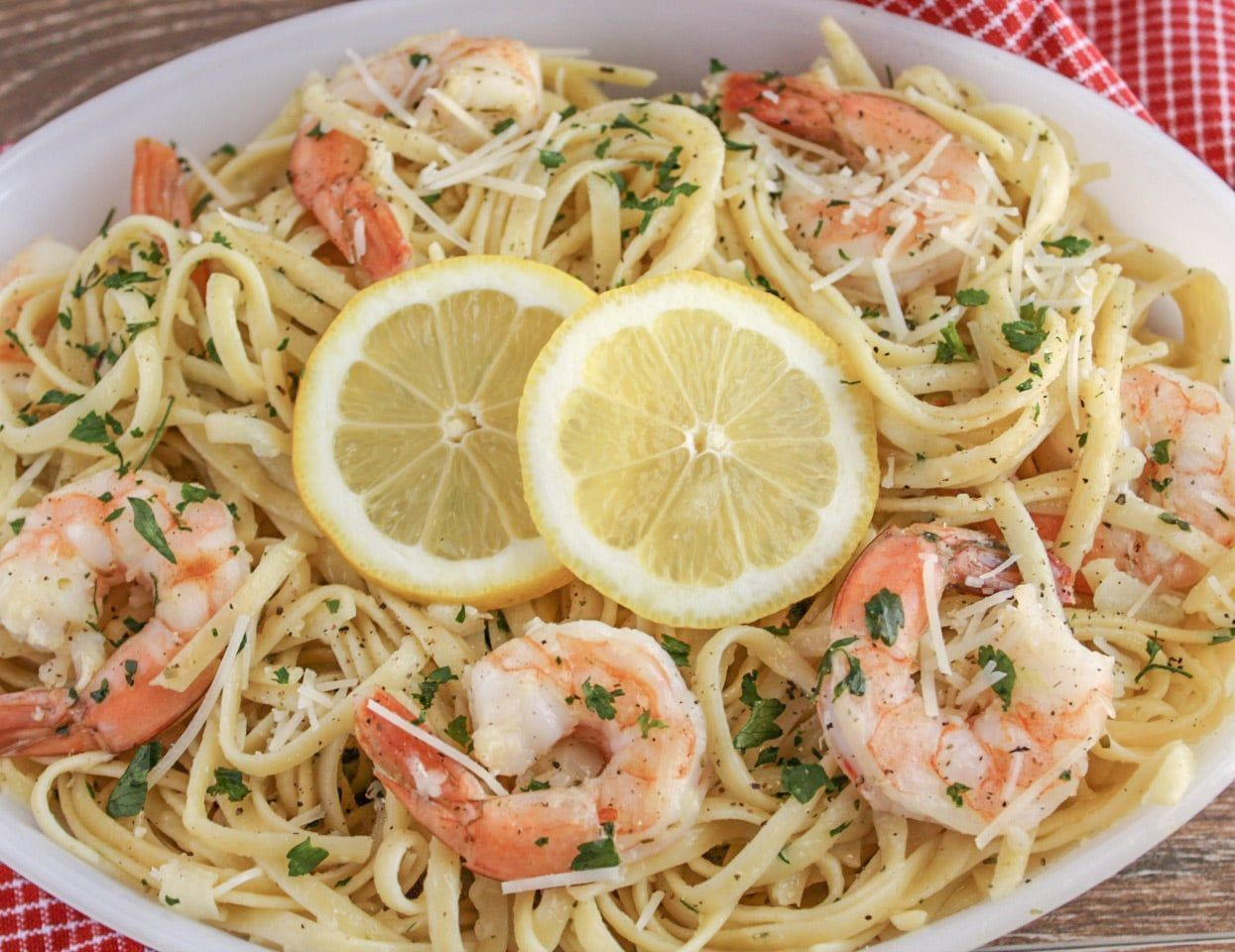 Lemon Garlic Parmesan Shrimp Pasta #garlicparmesanshrimp Lemon Garlic Parmesan Shrimp Pasta is an easy 30 minute recipe that features tons of savory shrimp tossed in pasta with a lemon garlic sauce and parmesan cheese. This recipe is sure to become a new family favorite! #garlicparmesanshrimp Lemon Garlic Parmesan Shrimp Pasta #garlicparmesanshrimp Lemon Garlic Parmesan Shrimp Pasta is an easy 30 minute recipe that features tons of savory shrimp tossed in pasta with a lemon garlic sauce and parm #garlicparmesanshrimp