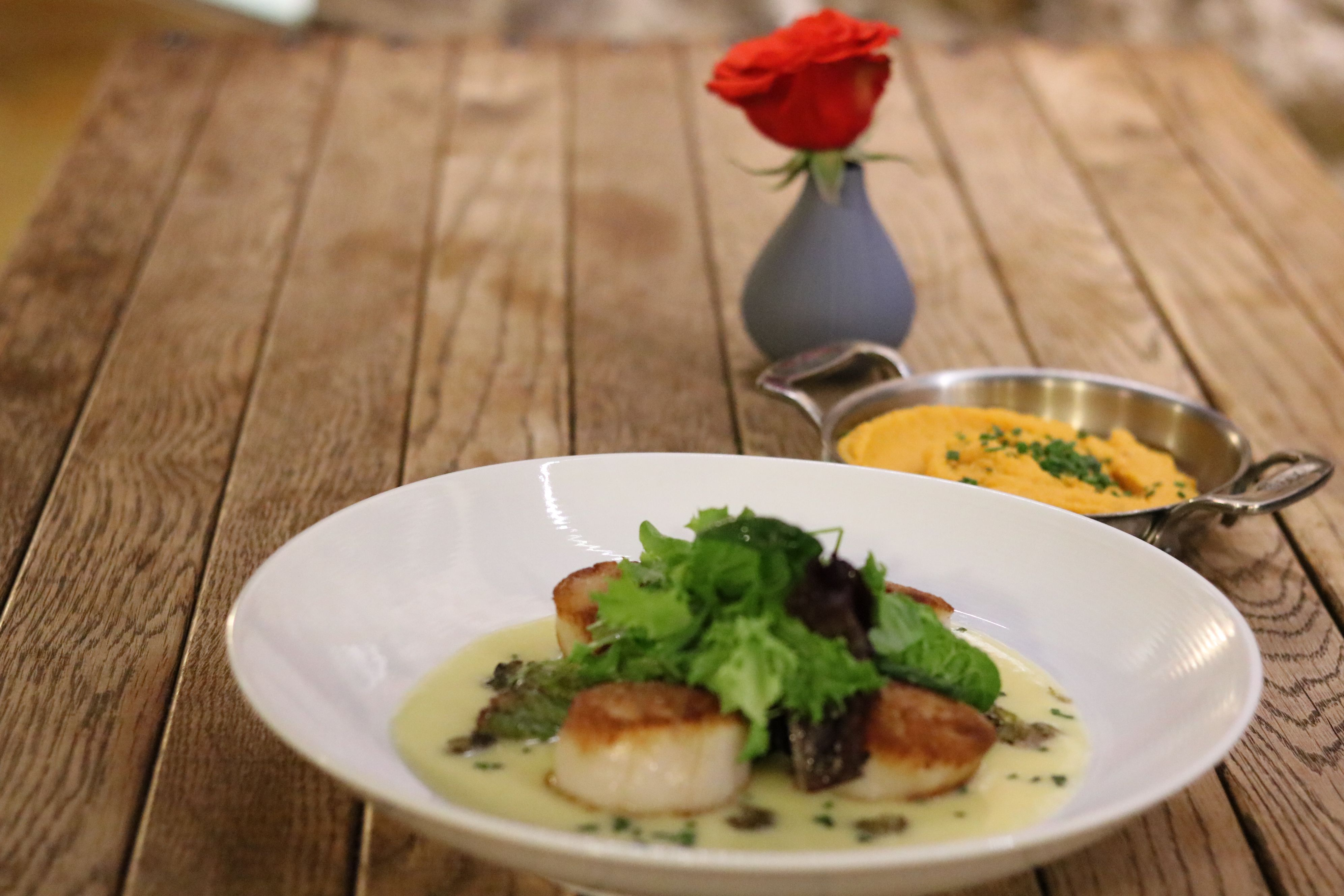 Scallops in a butter wine caper sauce & chipotle mashed potatoes! #theport #stjameshotelrw #foodies