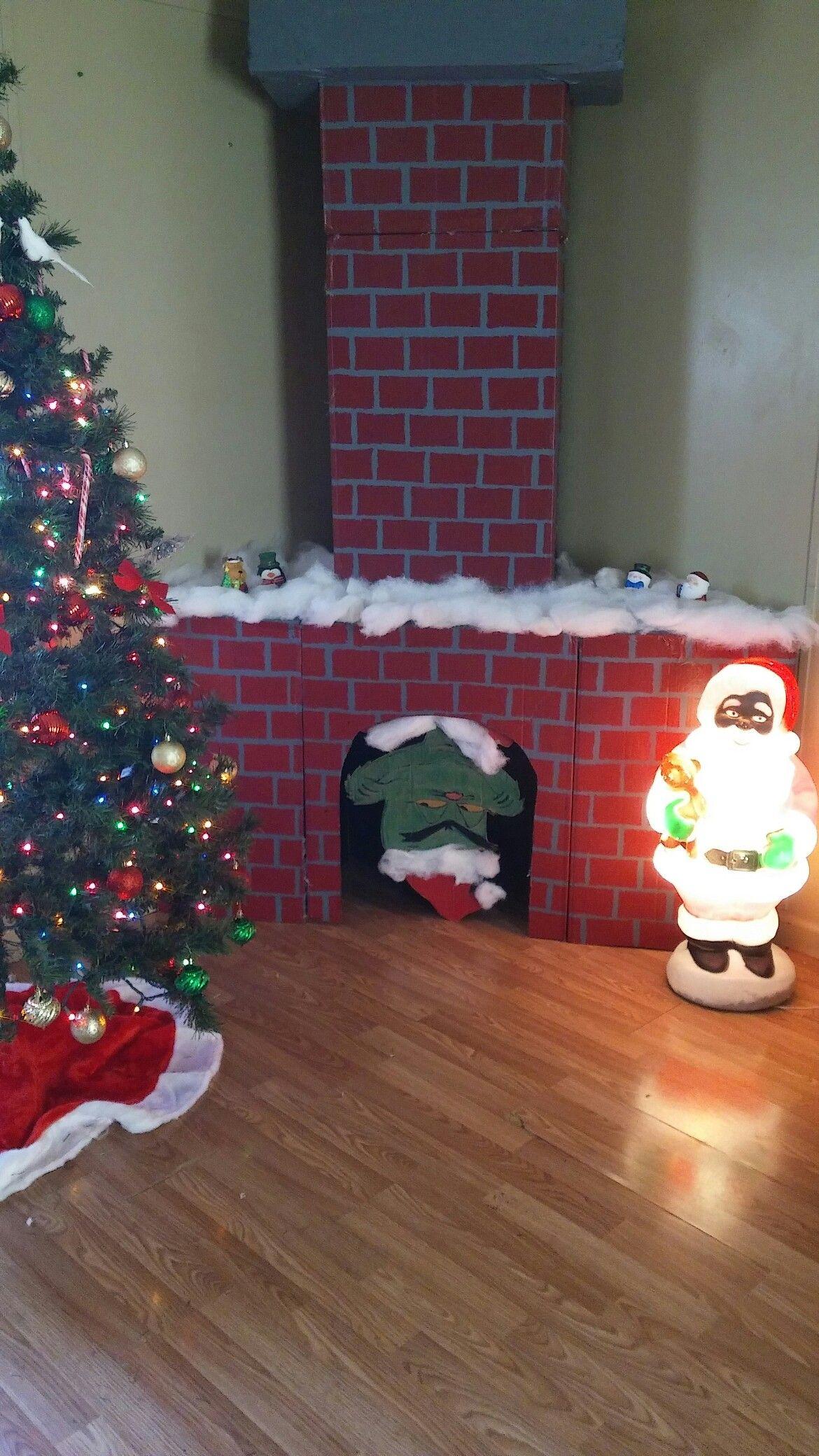 Faux cardboard fireplace with chimney and the grinch diy christmas