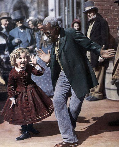 Photo f From left: Shirley Temple dances with Billy 'Bojangles' ROBINSON on the set of TK, in 1935.