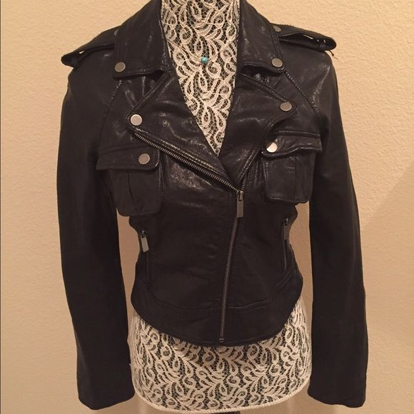 Bebe Leather Moto Jacket Genuine leather moto jacket. Bought from another seller, but didn't quite fit the way I had hoped. My loss is your gain... This is a CUTE leather jacket. bebe Jackets & Coats