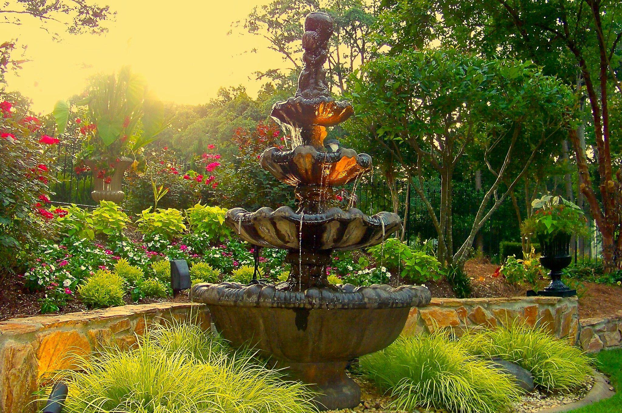 front yard fountain at dusk