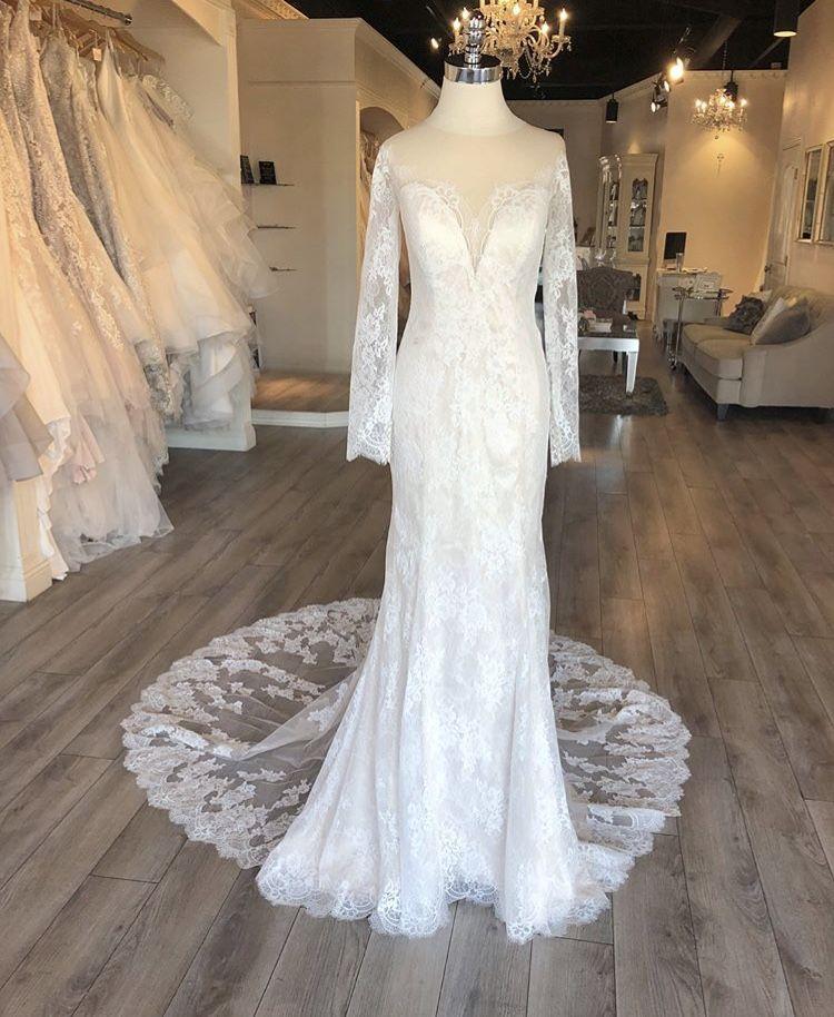 Long sleeve lace weddingdress with deep v low back lace