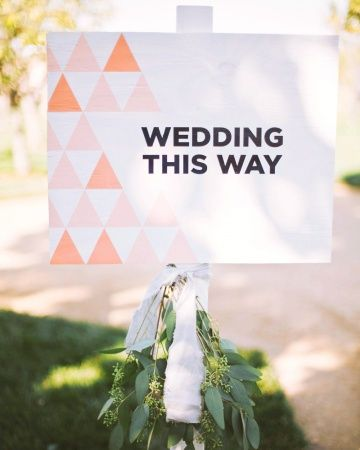"""Giddy Guideposts  Stenciled wooden boards let Alexa and Matthew's friends and family know they'd come to the right spot. Other signs between the ceremony and cocktail-hour locations encouraged, """"Keep Going"""" and """"Almost There."""""""