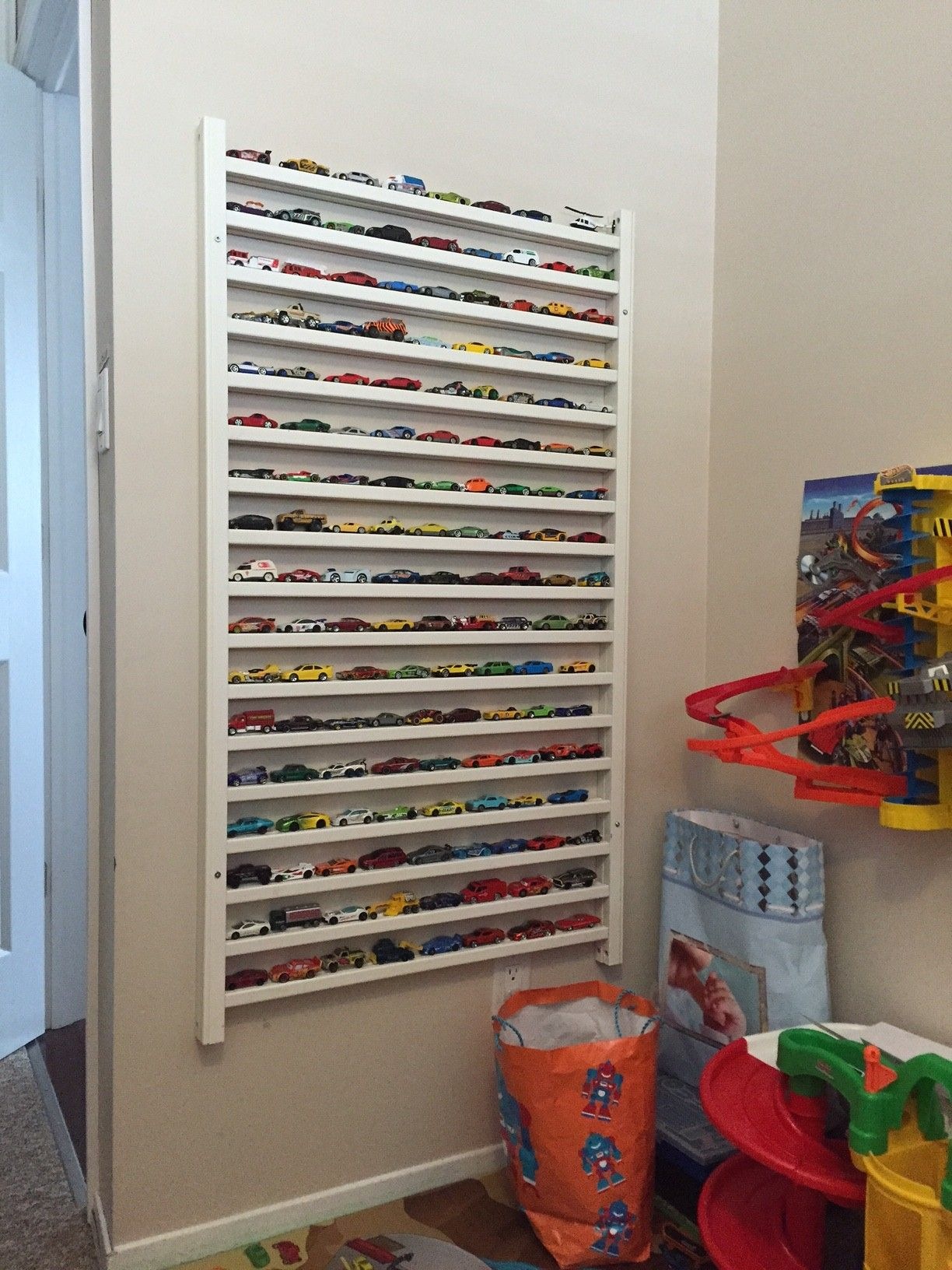 a bookshelf i made for josh's room from the removed side of the  - diy hot wheels matchbox diecast car display using side rails from an oldcrib (trains