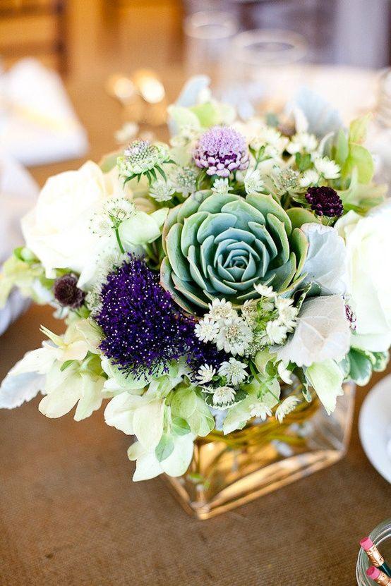 Succulent centerpiece -- add some Ranunculus and Craspedia