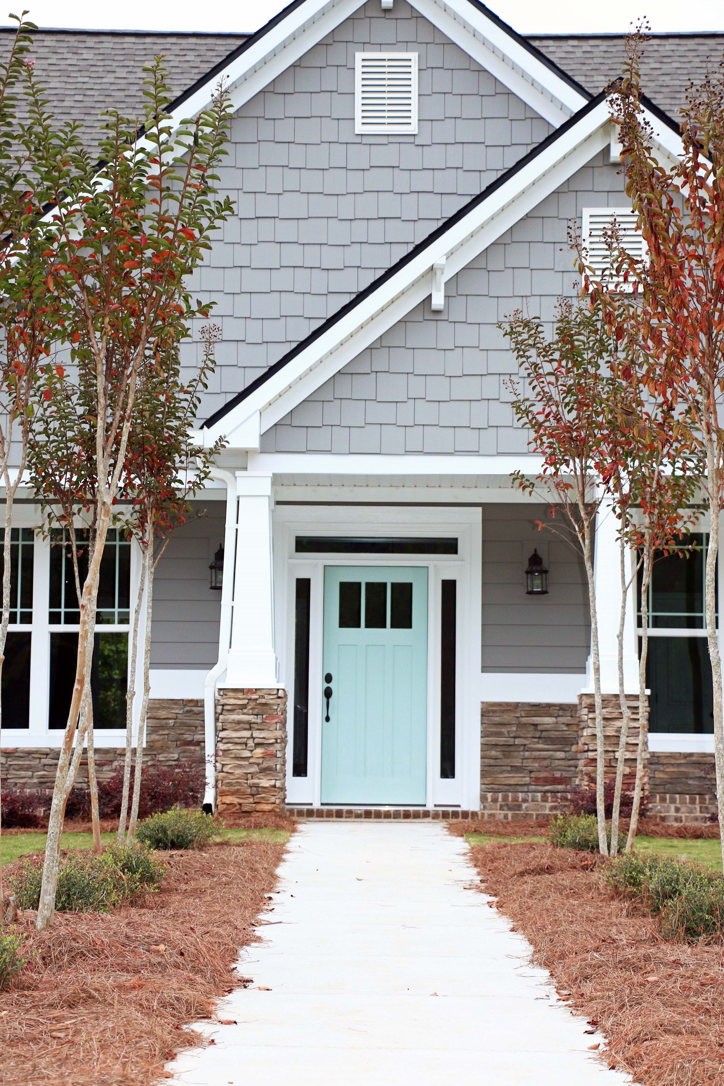 Door: Waterscape By Sherwin Williams; Siding: Dovetail By Sherwin Williams