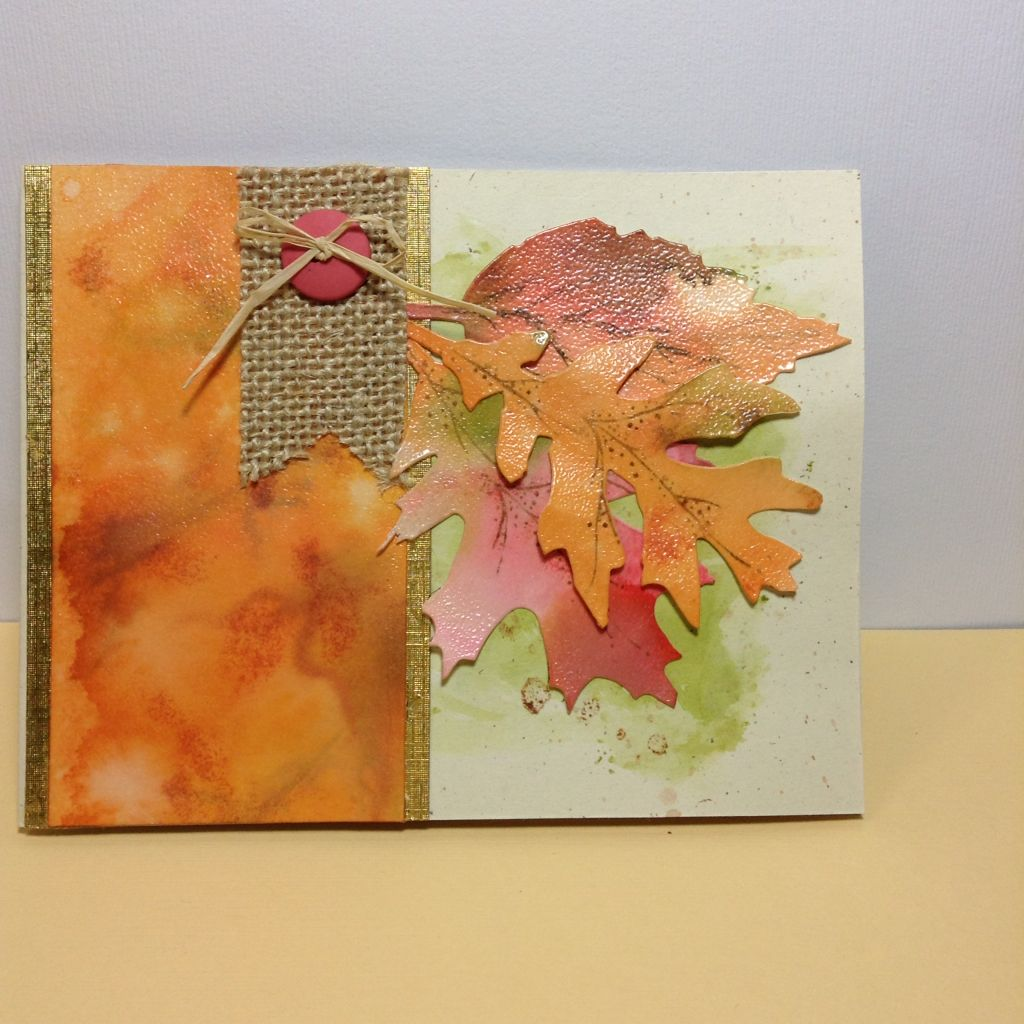 Fall card. Clear embossed over distress inks. Sizix leaves.