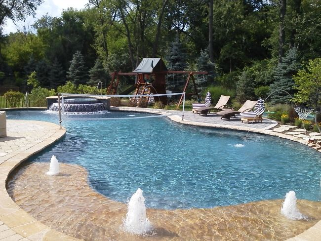 Picture of a pool with volleyball net and water jets in for Water pool design