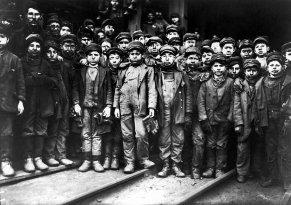 """Group of """"breaker boys,"""" child miners, who work in Ewen Breaker, separating coal from slate, photographed in effort to ban child labor. January 10, 1910."""