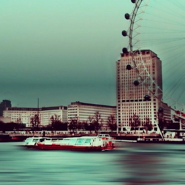 London Eye, Westminster.    I tried to get the silky water effect using Photowizard app. Then used one of the Gradient effects from Photo fX app. - @atariq7- #webstagram