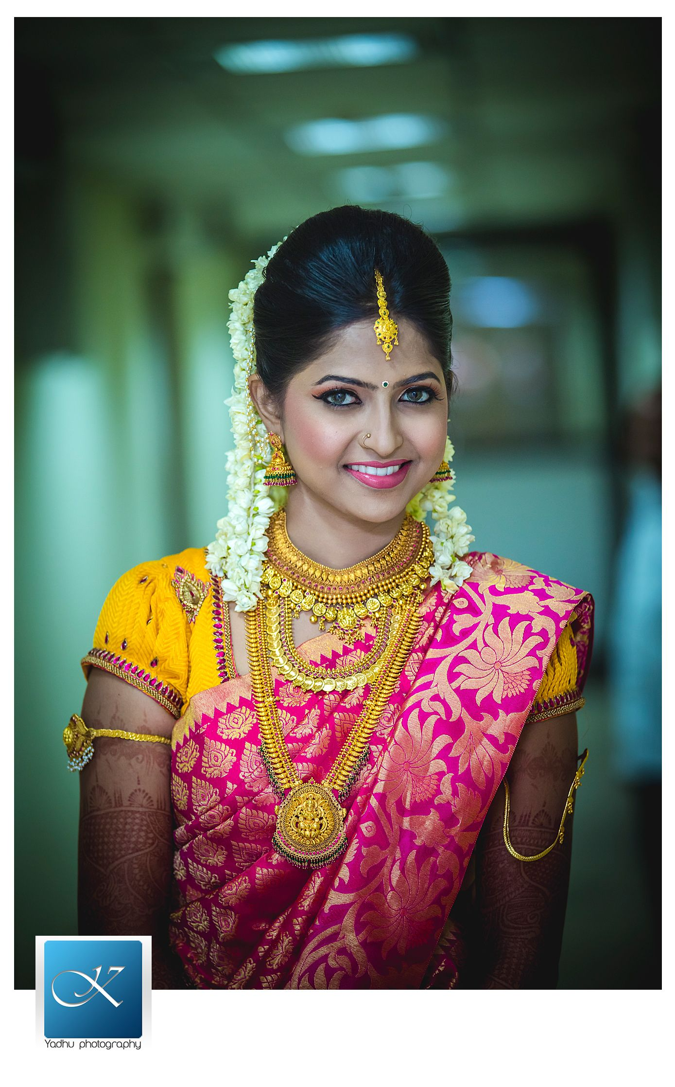 Traditional Southern Indian bride wearing bridal saree, jewellery ...