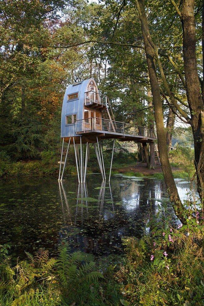 Unusual Forest Cabin On Stilts Over Pond | architecture design