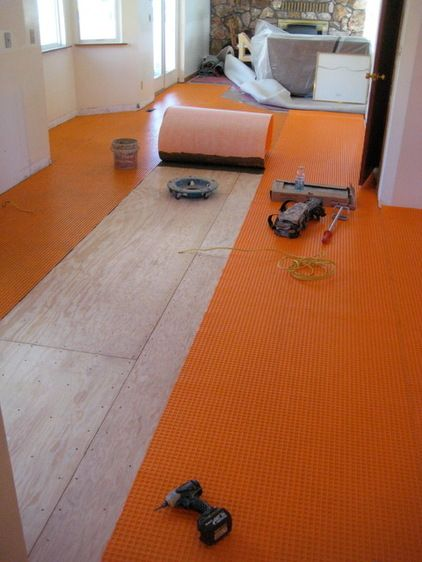 Prepping For A Tile Installation With A Second Layer Of Plywood And An Uncoupling Membrane By Tarkus Tile Inc Wood Floors Flooring Wood