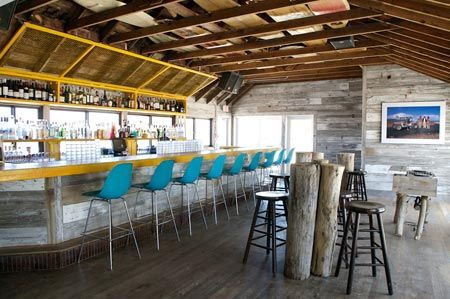 Surf lodge in montauk very cool place and great people for Surfboard bar top ideas