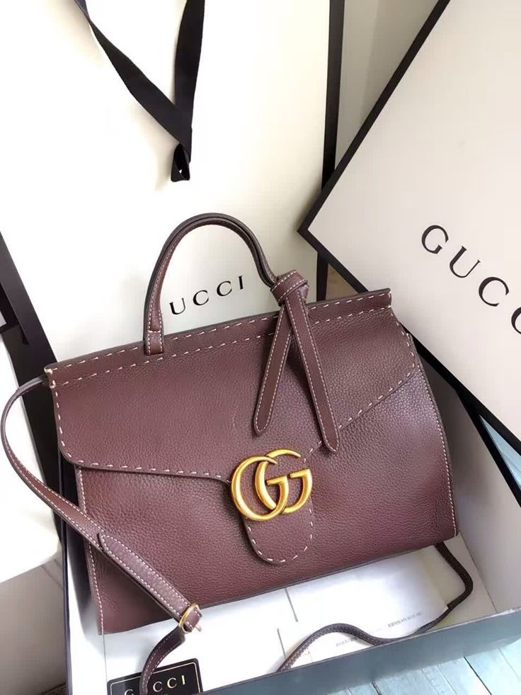 606b0170d68b9 ... discount designer handbags are always on sale. Gucci Small GG Marmont  Leather Top Handle brown. See more luxurious designer bags at http