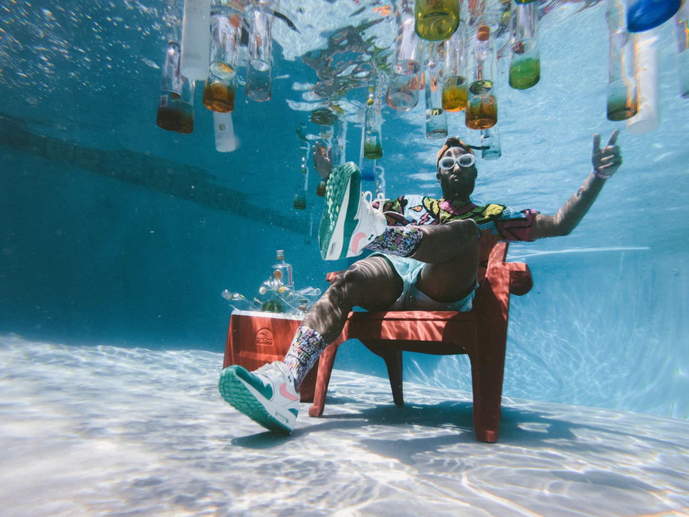 Man Sitting On Chair Underwater With Floating Bottles Photo Free Pool Image On Unsplash Pool Full Of Liquor Pool Parties Pictures Pool Picture