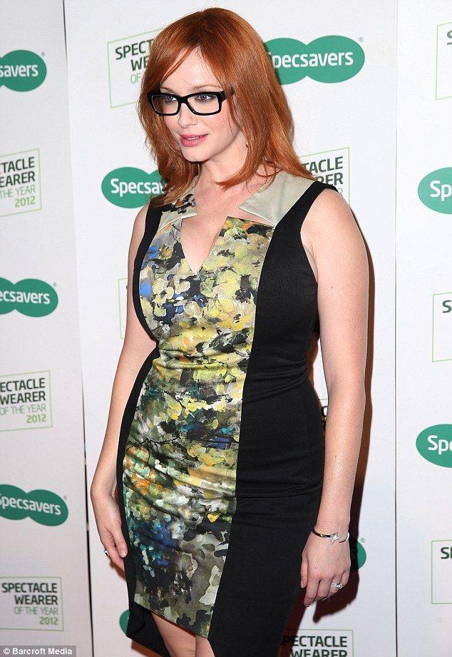 Hot redhead in short green dress