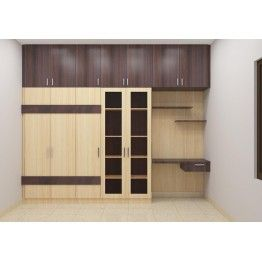 Modular wardrobe with double color combination. Made up of plywood and laminate finish. 5 door wooden wardrobe with loft, study unit, book shelf being functional also offers great beauty. Customize this wardrobe to maximize the bedroom space. The laminate selection can be made as per user accordance.