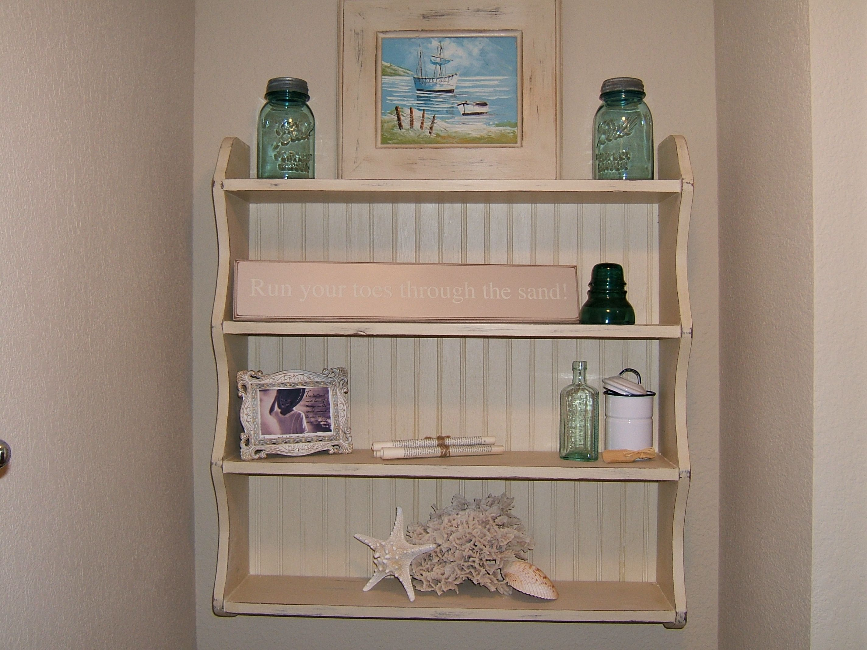A vintage wall shelf with the addition of a bead board back has been painted in Annie Sloan's Old Ocre chalk paint.