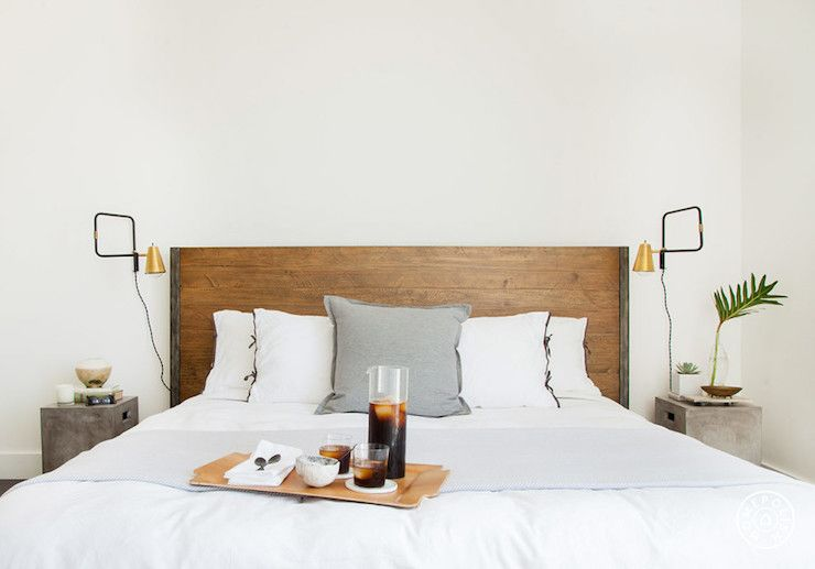 A Plank Wood Headboard Accents Bed Dressed In White Bedding With Black Ribbon Trim And A Single Gray Flannel Pillow Flanked By Home Decor Decor Inspired Homes