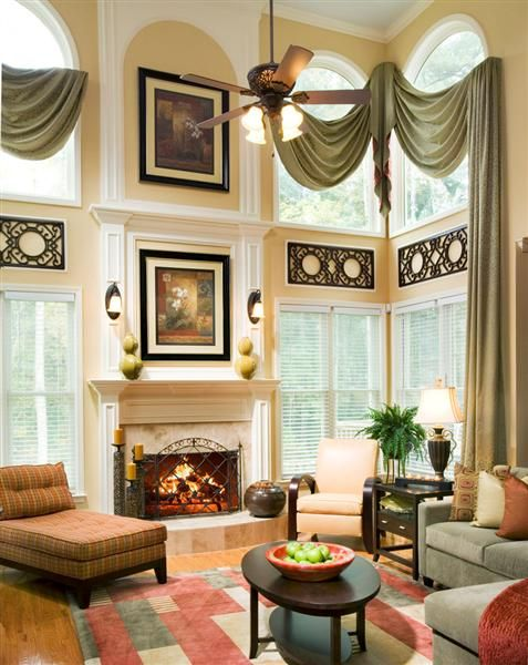 tall ceilings draw the eye up with visual elements and large art