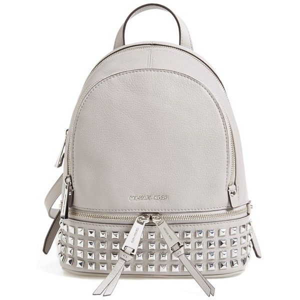 70d38ac43730 MICHAEL Michael Kors Extra Small Rhea Zip Studded Backpack ($298) ❤ liked  on Polyvore featuring bags, backpacks, pearl grey, grey bag, michael kors  ...
