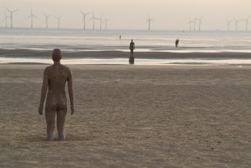 Photo of Anthony Gormley's statue and wind farm, Crosby Beach