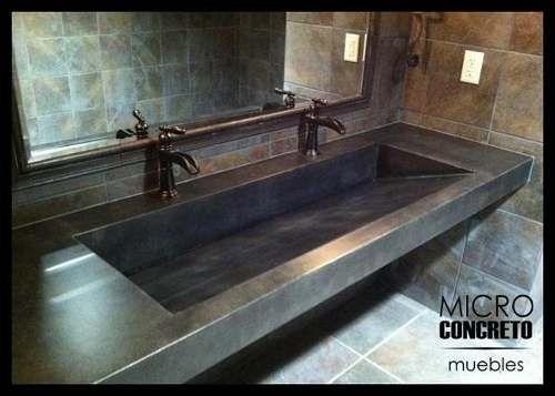 baño de pared de concreto mesadas en microcemento cemento alisado silestone