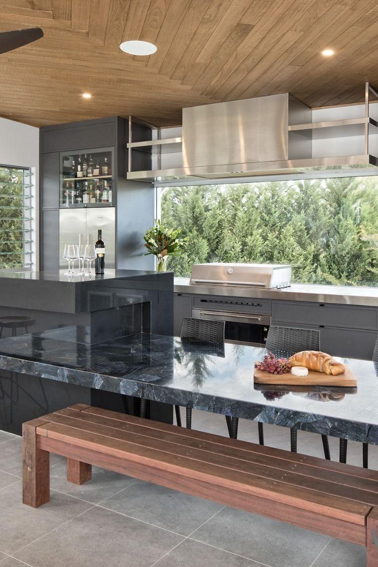Indoor Outdoor Kitchen featuring a custom made hood