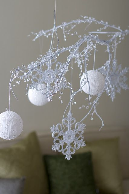 a branch sprayed white then a crystal garland attached,  so pretty.