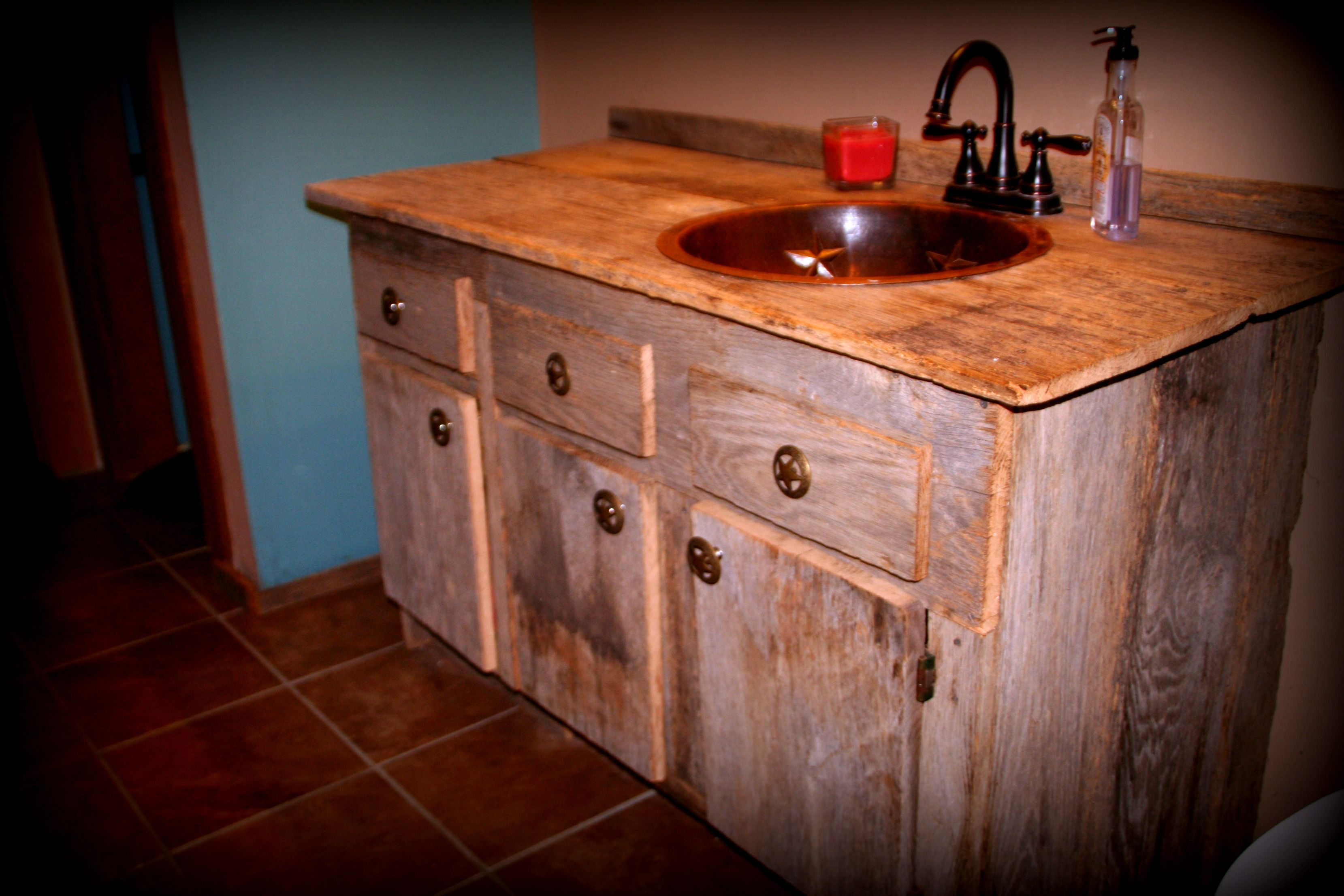 Bathroom vanity made from barn siding salvaged from old for Barn wood salvage companies