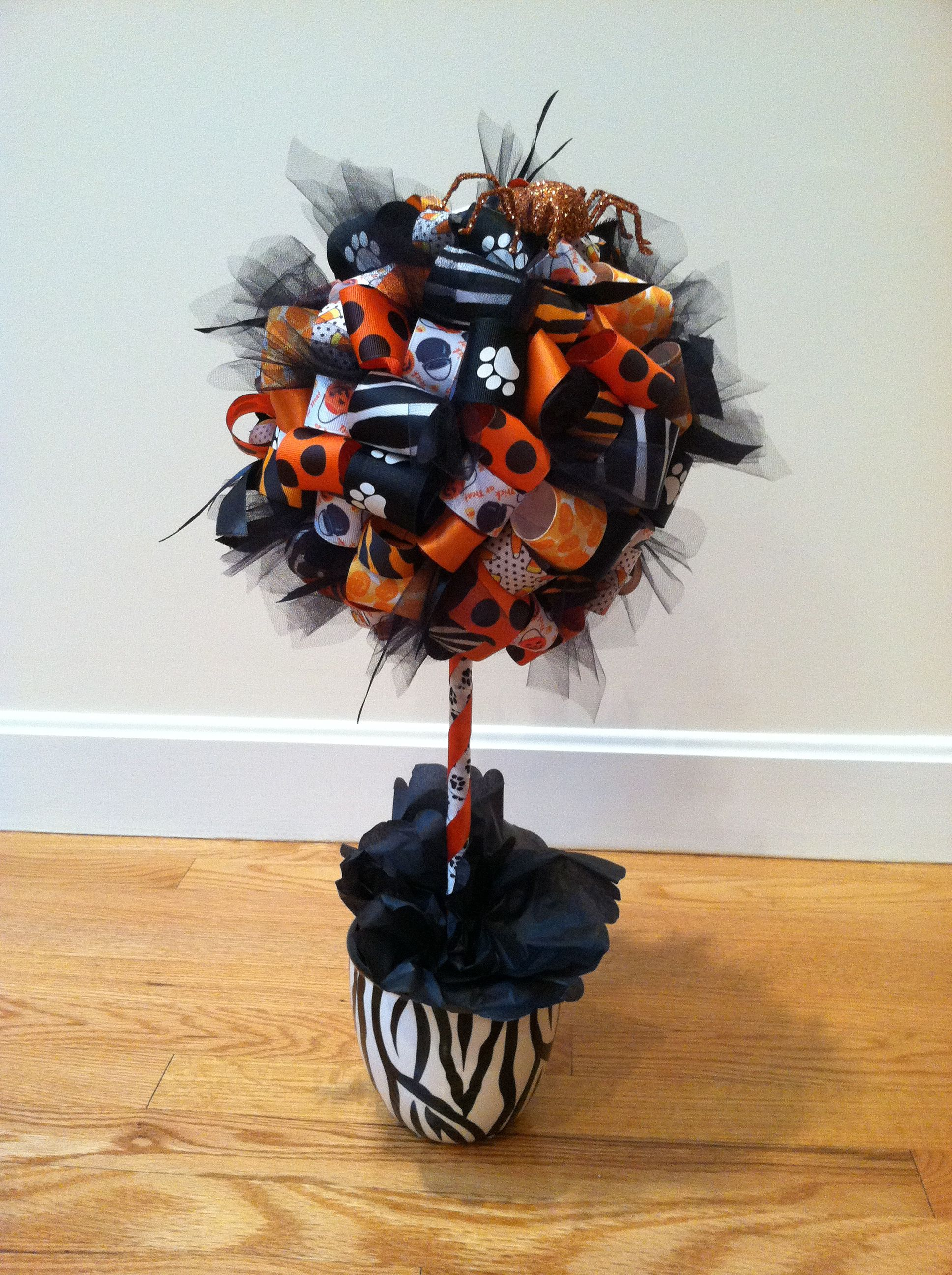 This fun topiary includes our animal prints for a sweet Halloween theme!