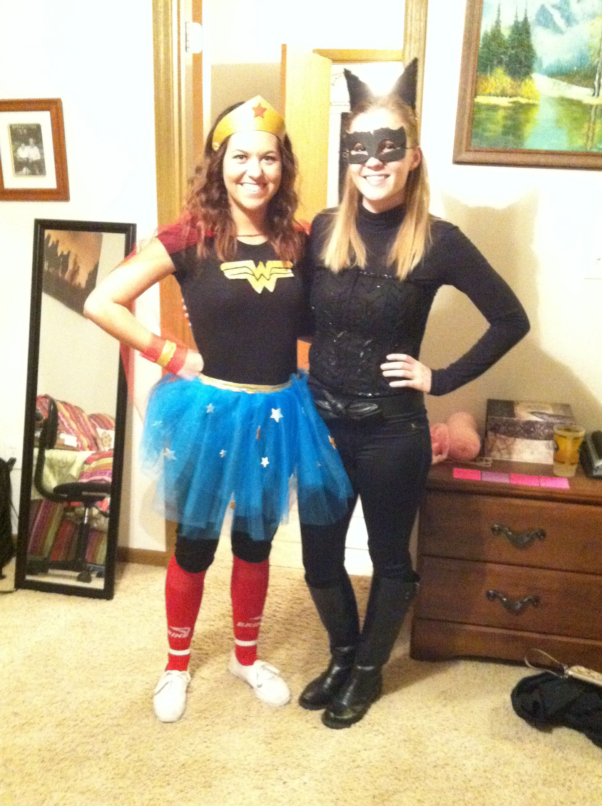 Wonder women and cat women! Fighting crime! Halloween