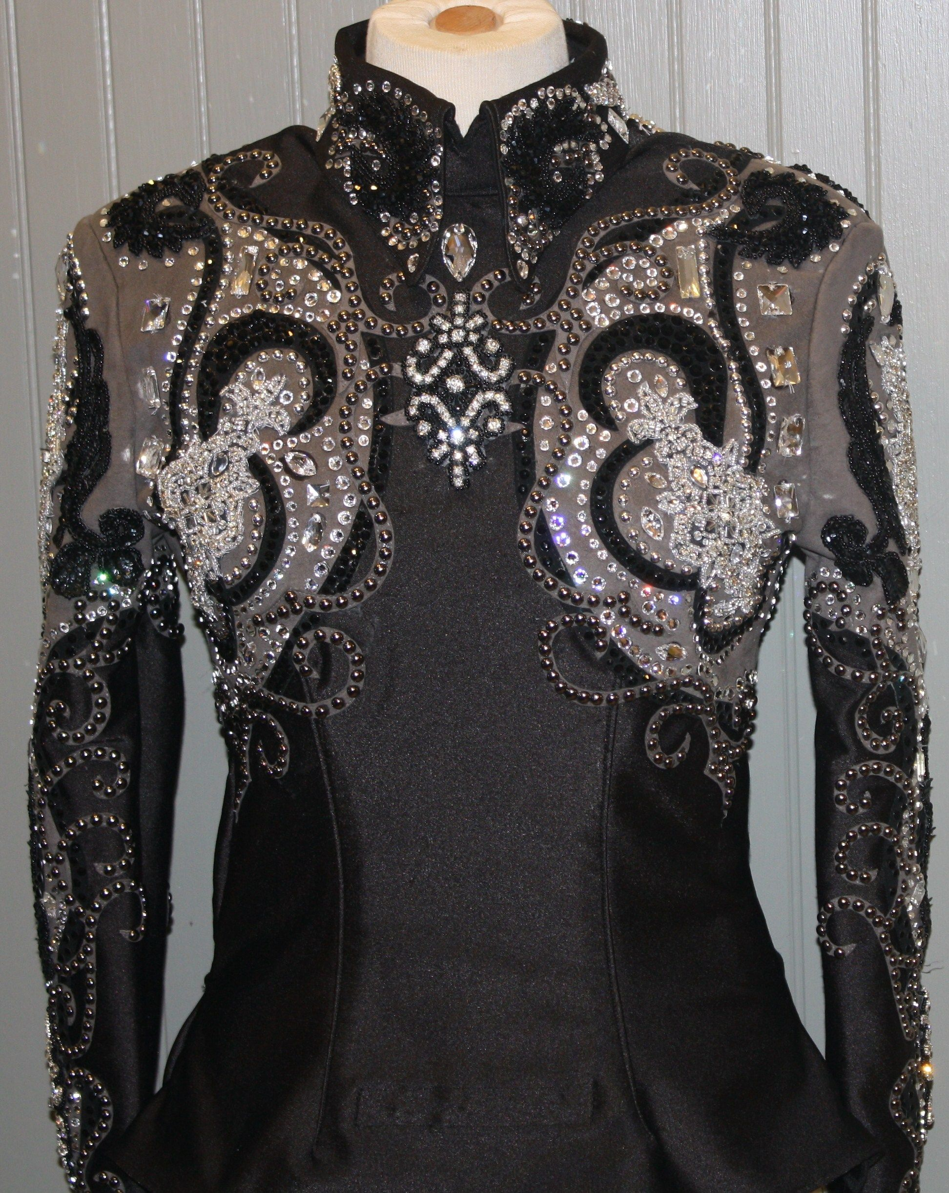 """New Horsemanship Shirt for sale $2995... Gorgeous horsemanship shirt made by Showing Style. Black, Gunmetal Grey and Silver. This custom shirt is edgy and elegant all rolled into one. Made out of a stretch blend fabric. Approximate measurements: Bust - 35 Waist – 30 Hips – 36 Shoulder width – 17 Sleeve Length – 26 Center Back Length – 23 2"""" side seam"""