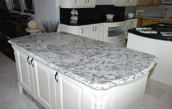 white delicatus ice-countertop on island, with black ...