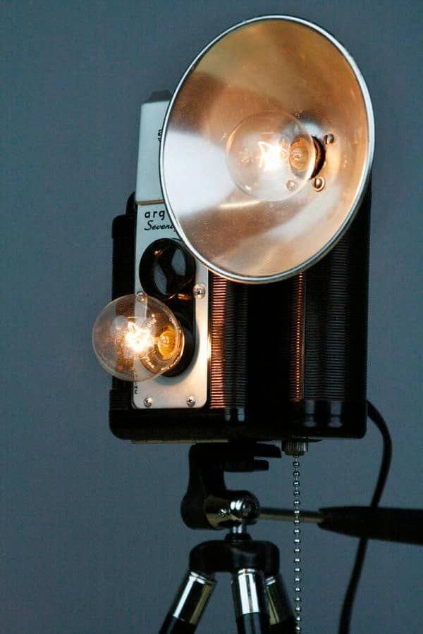 Repurpose of vintage cameras into functional floor lamps
