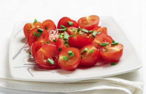 To slice a heap of cherry tomatoes in one go, simply place them all between two plates and, holding ... - Gourmandize