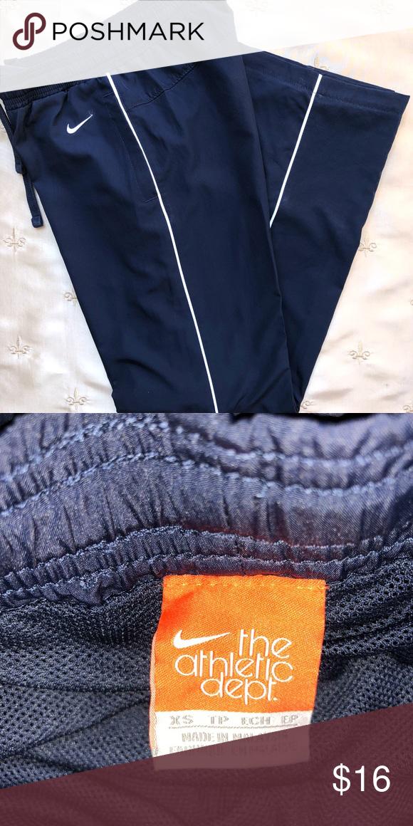 a778fe34ba00 Nike full length track pants Navy with white stripe