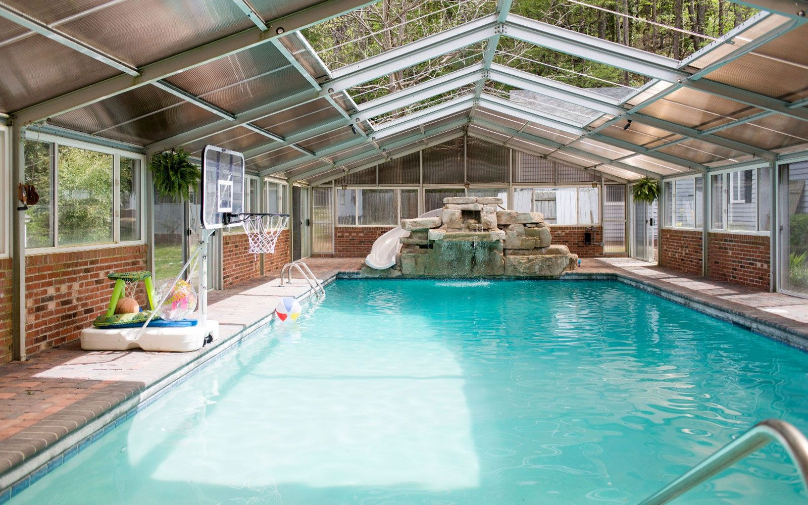 Unique Group Rental Homes Perfect For Group Getaways Indoor Outdoor Pool House Rental Pool Houses
