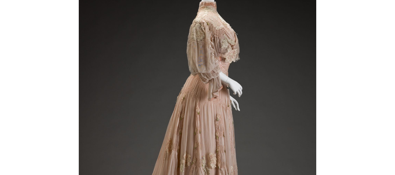 day dress Girolamo Giuseffi, Designer (American, 1864-1934) G. Giuseffi Ladies' Tailoring Company, Design House (American)..The appliquéd and cutout stylized flowers—either peonies or plum blossoms—are drawn in an Art Nouveau style, which was prevalent from 1890 to 1914. The dramatic sleeve silhouette along with the great amount of ruching and hand pin tucking throughout the bodice and skirt make this a very expensive garment, perhaps part of a trousseau.