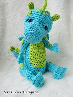 This cute whimsical fellow is definitely fun to create with bright cottons. Uses basic crochet stitches and crocheting in the round. Finished dragon is approx. 14 inches tall from the top of is head to the bottom of his feet. Pattern includes detailed written instructions (in English), a materials list (you will need one pair of 15 mm safety eyes to give your dragon his cute personality), and hints and tips to help you finish your dragon.