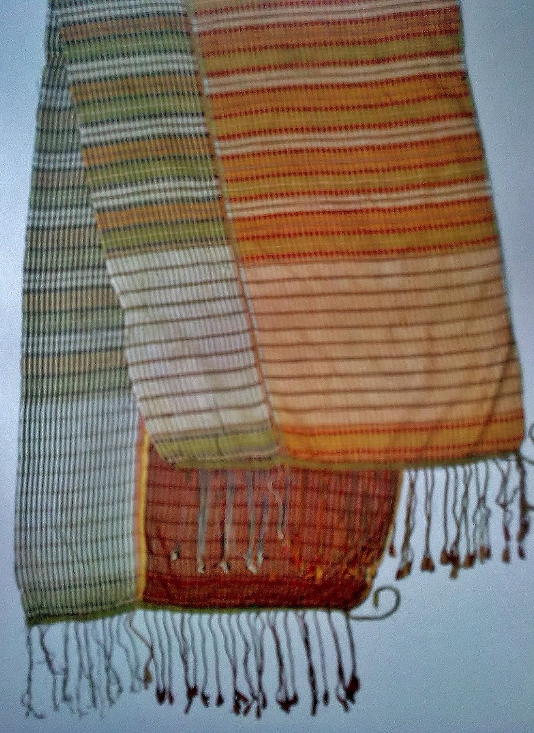 A silk sash (waistband) from Cyprus.  Used in the traditional urban costumes.  The centre of Cypriot silk production was to be found in the area of Lapta and Alsançak where the climate was favourable for the mulberry tree.  Colours and design are similar to the silk waistbands of the Silifke region (Southern Anatolia).