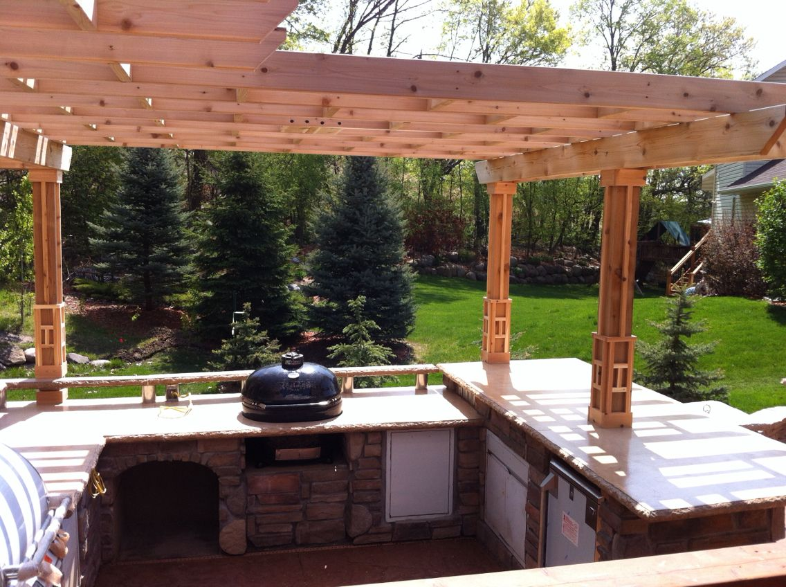 Outdoor kitchen with custom concrete countertops pergola for Outdoor kitchen pergola ideas
