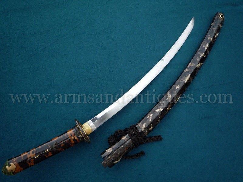 Beautiful 19th C. Japanese Wakizashi Sword with gold accented fittings and Moko pattern tsuba